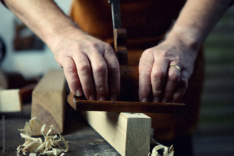 Carpenter working with wood. by kkgas for Stocksy United
