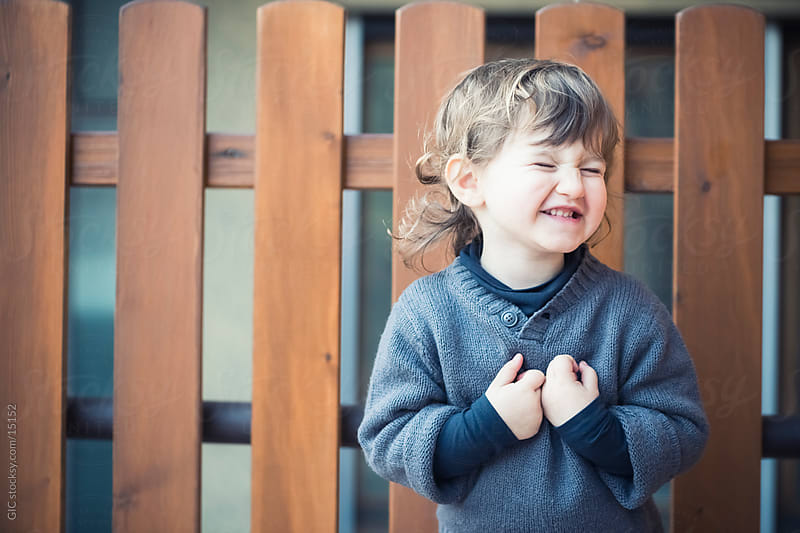 Little girl laughing outdoors by GIC for Stocksy United