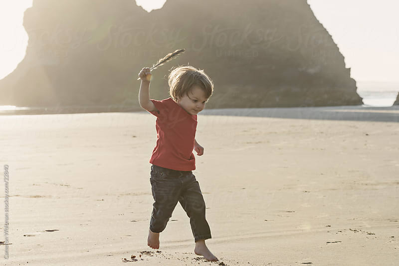 Little Boy Running On The Beach by Cameron Whitman for Stocksy United