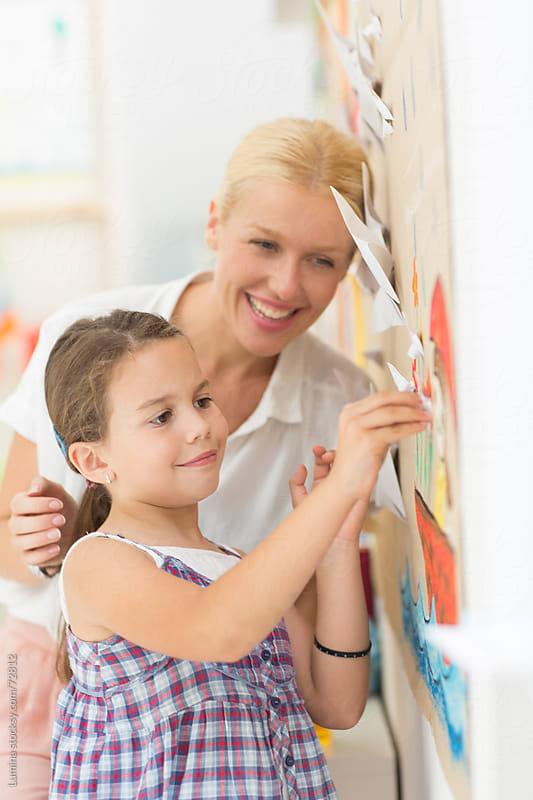 Preschooler and Her Teacher Making Paper Butterflies by Lumina for Stocksy United
