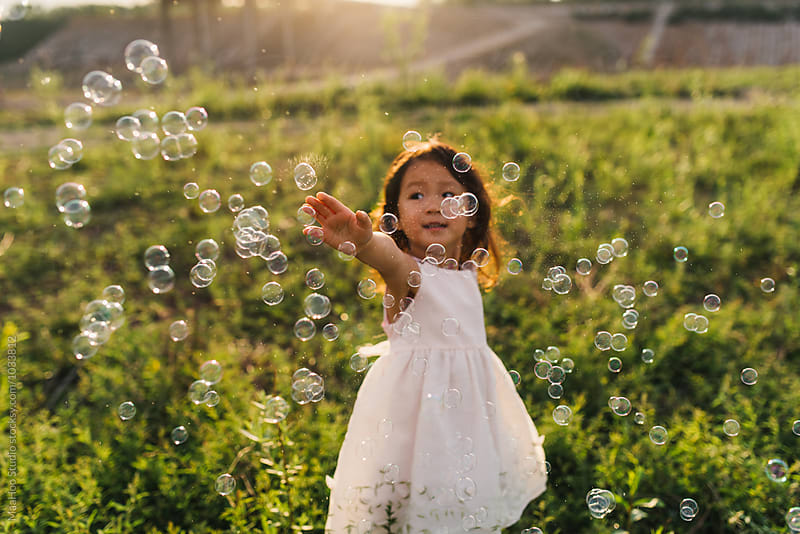 Cute little girl playing with bubble by Maa Hoo for Stocksy United
