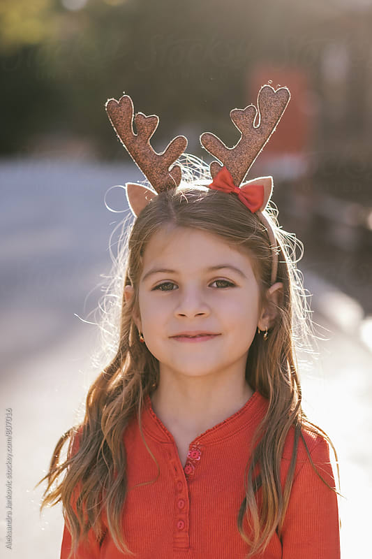 Portrait of a Beautiful Littile Girl with Reindeer Horns  by Aleksandra Jankovic for Stocksy United