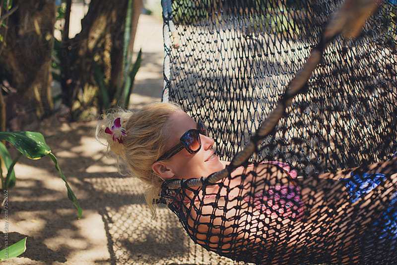 Blonde Woman Lying in a Hammock by Lumina for Stocksy United