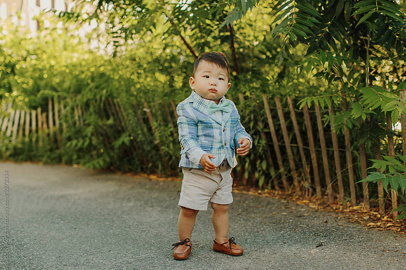 Korean Baby in front of Fence by Sidney Morgan for Stocksy United