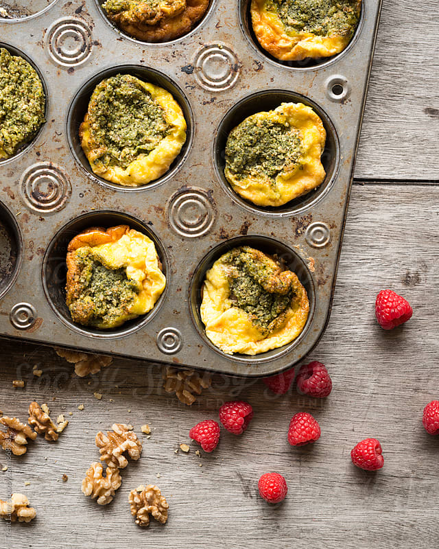 Close-up of baked frittata with pesto by Trent Lanz for Stocksy United