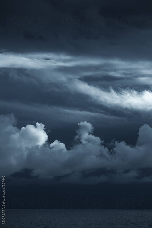 Dark dramatic storm clouds over the open ocean. by RZ CREATIVE for Stocksy United
