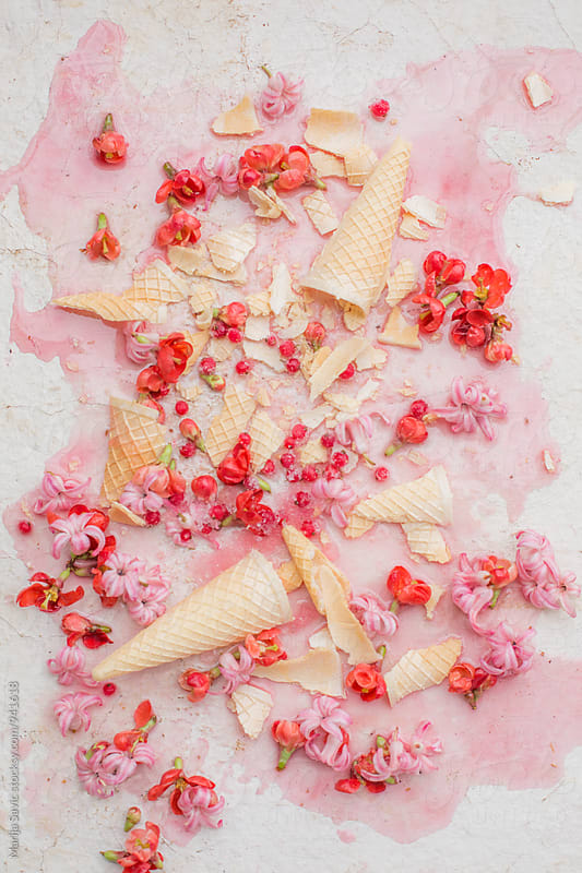Waffle cones scattered on melted ice cream by Marija Savic for Stocksy United