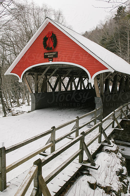 New Hampshire Covered Bridge during Holidays by Raymond Forbes LLC for Stocksy United