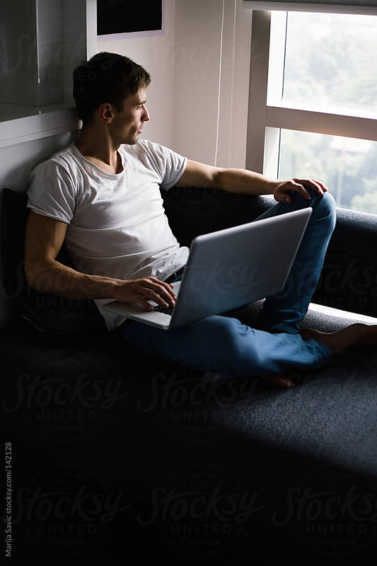 Young Man Working on Laptop at Home. by Marija Savic for Stocksy United