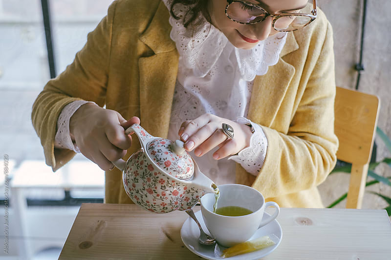 Woman Pouring Green Tea by Aleksandra Jankovic for Stocksy United