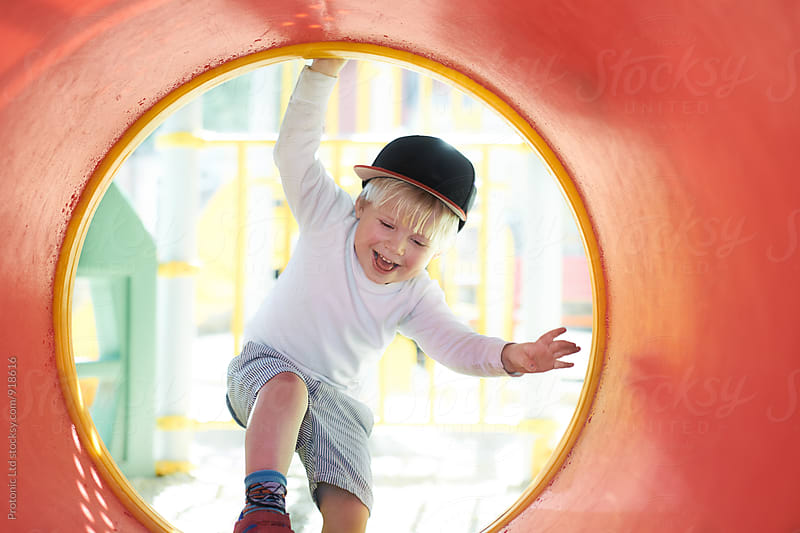 3 year old happy boy on a playground by Per Swantesson for Stocksy United