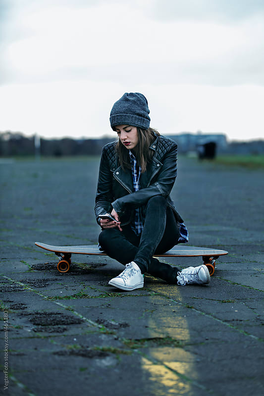 Young woman Texting  by VegterFoto for Stocksy United