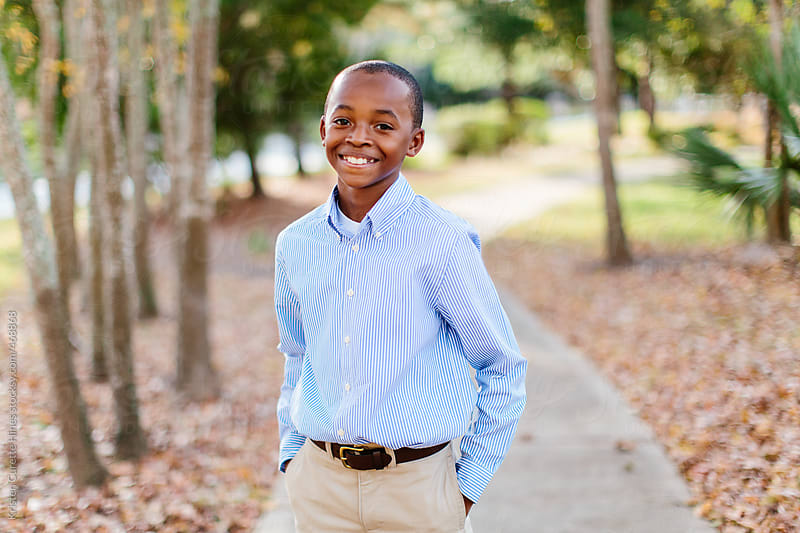 Portrait of a young African American boy  by Kristen Curette Hines for Stocksy United