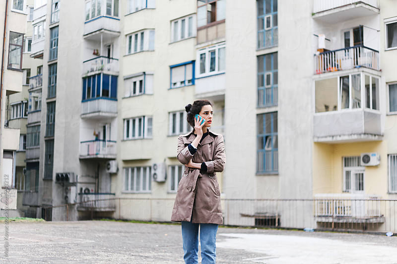 Caucasian woman talking on her cell phone by Marija Kovac for Stocksy United