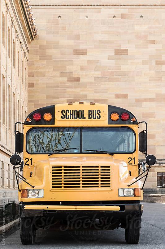 School bus in a parking lot by Melanie Kintz for Stocksy United