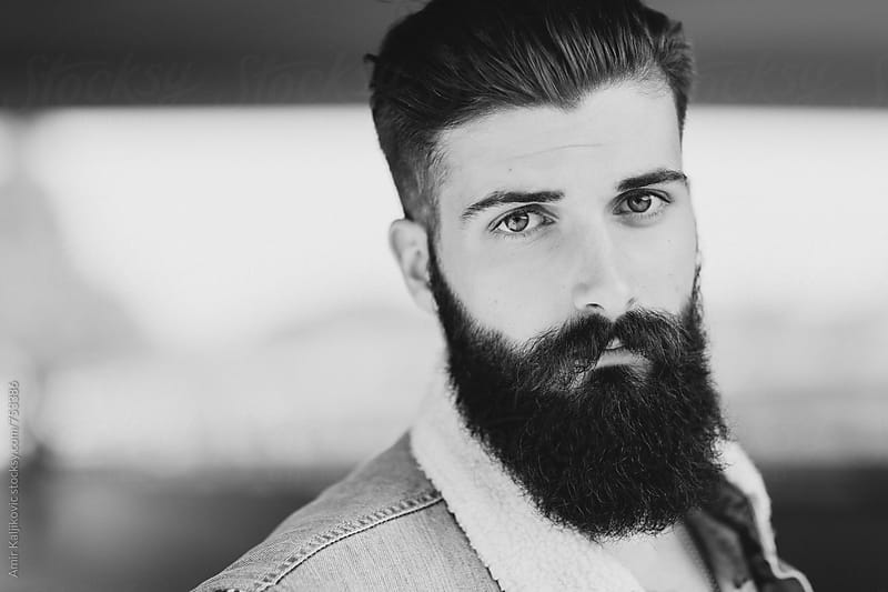 Portrait of Serious Young Man with Beard by Amir Kaljikovic for Stocksy United