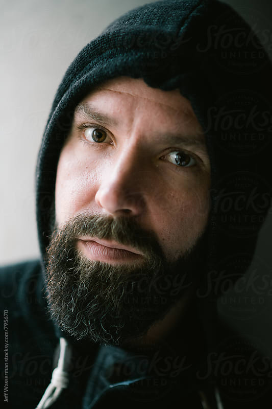 Portait of Man in Hoodie by Jeff Wasserman for Stocksy United