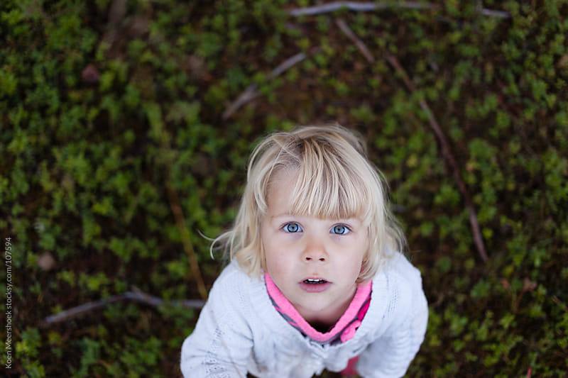 Cute girl looking up straight in the camera. by Koen Meershoek for Stocksy United
