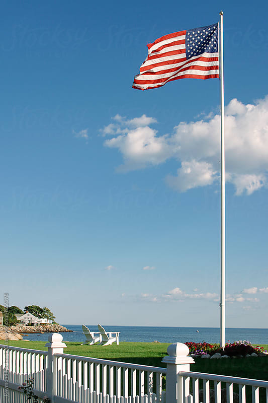 American Flag at Coastal Location with Adirondack Chairs by Raymond Forbes LLC for Stocksy United