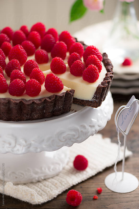 chocolate cheese tart with raspberries by Laura Adani for Stocksy United
