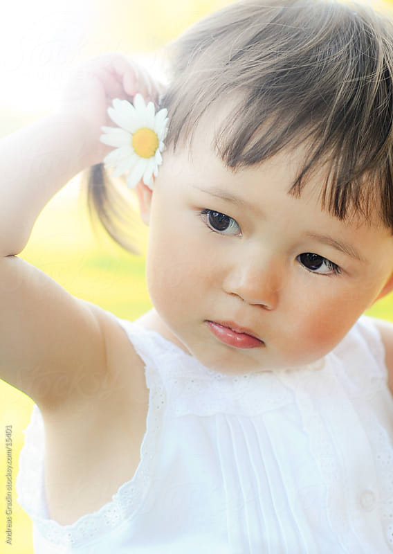 summer portrait of a cute asian child by Andreas Gradin for Stocksy United