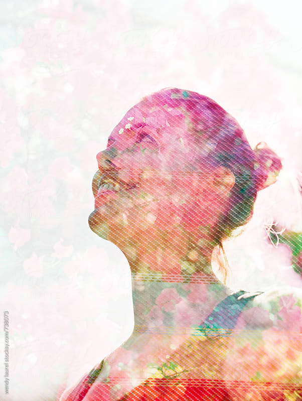 film double exposure of woman wtih pink florals by wendy laurel for Stocksy United