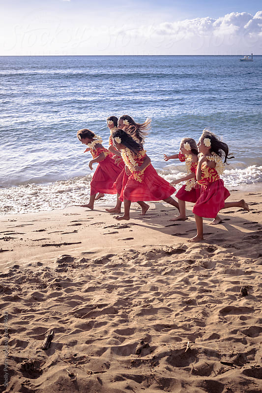 Group of Young Traditional Hawaiian Hula Dancers Running and Playing on the Beach by Shelly Perry for Stocksy United