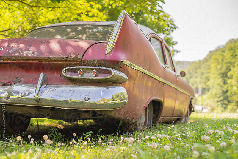 Abandoned American Car Rusts in a Field by suzanne clements for Stocksy United