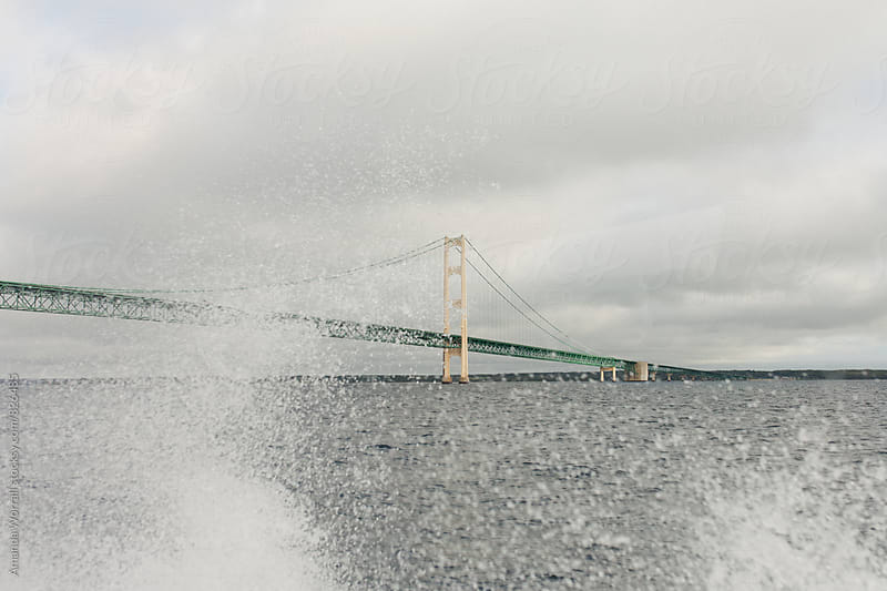 A view of the Mackinac Bridge with water sprays from the wind by Amanda Worrall for Stocksy United