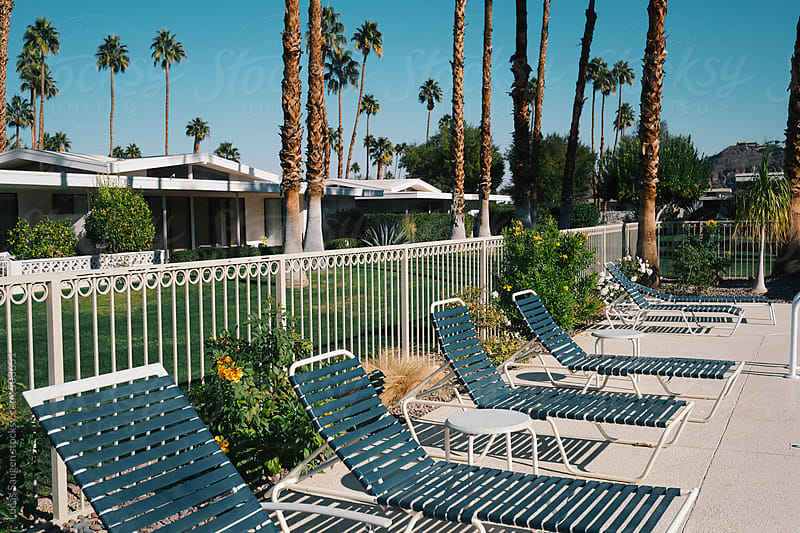 Chairs around an outdoor pool in Palm Springs by Lucas Saugen for Stocksy United