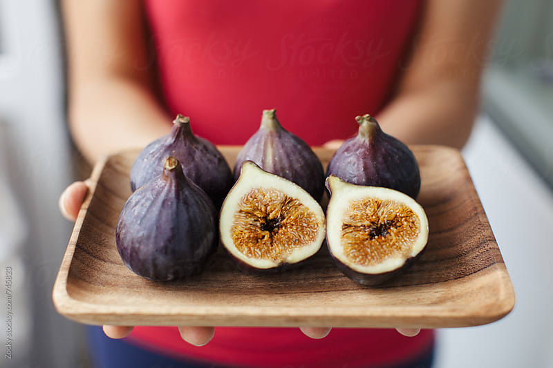 Raw fresh figs on wooden plate by Zocky for Stocksy United