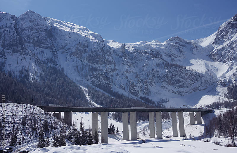 Highway bridge in alps landscape by Robert Kohlhuber for Stocksy United