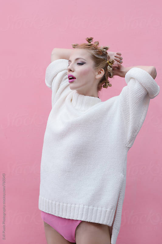 Portrait of a beautiful female rebel in sweater and body  by Branislava Živić for Stocksy United