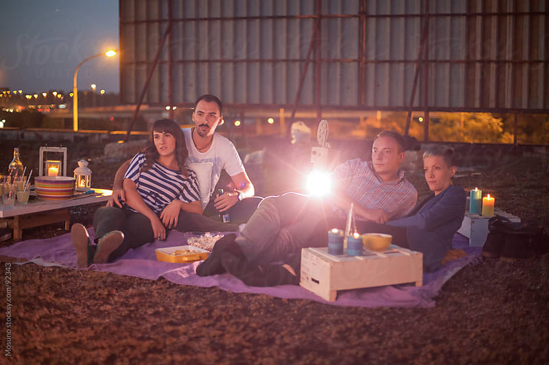 Couple's Movie Night in Open Air Cinema by Mosuno for Stocksy United