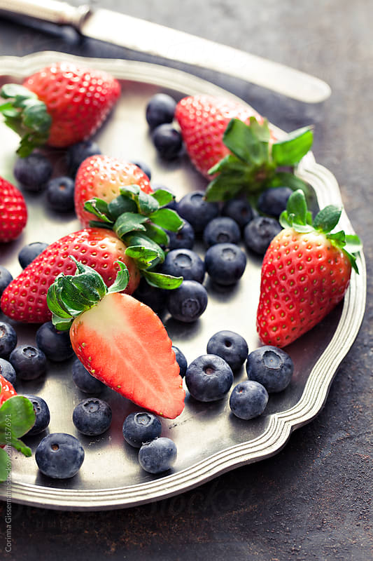 Strawberries and Blueberries  by Corinna Gissemann for Stocksy United