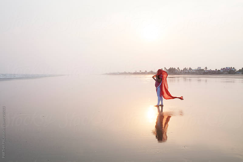 A woman enjoyes breeze in sea beach by PARTHA PAL for Stocksy United