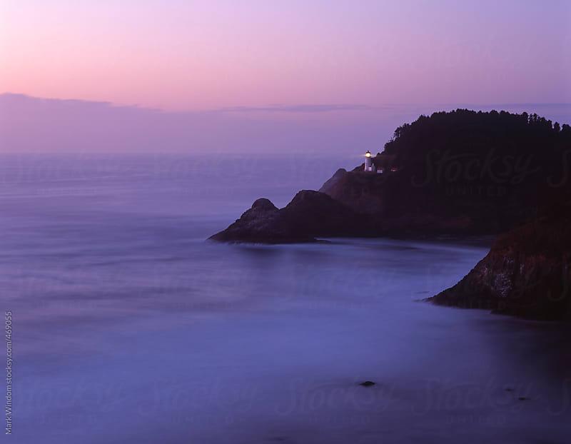 Heceta Head lighthouse at dusk, Oregon by Mark Windom for Stocksy United