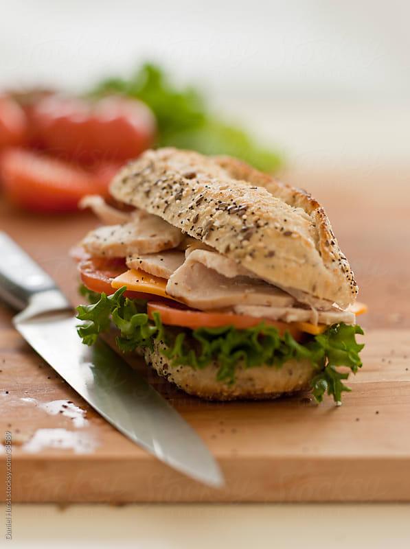 Sandwich on cutting board by Daniel Hurst for Stocksy United
