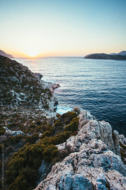 Sunset over an idyllic Greek island bay at sunset by Micky Wiswedel for Stocksy United