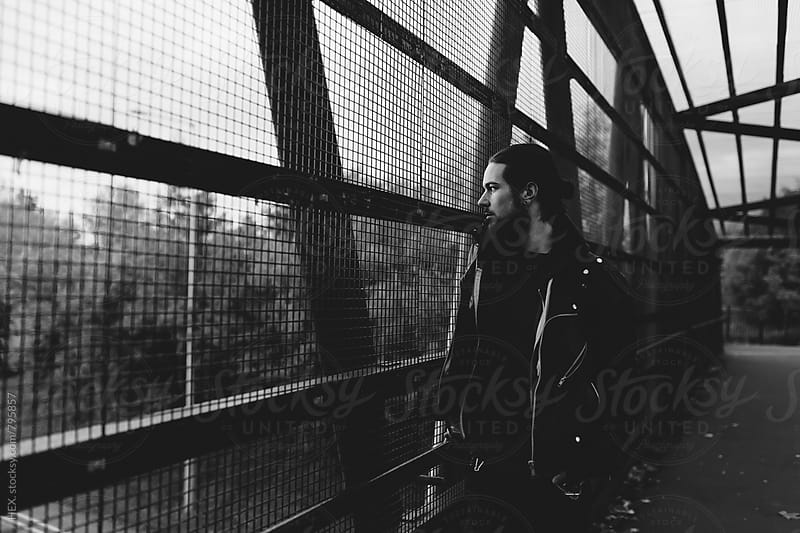 Handsome Man Walking on the Bridge by HEX. for Stocksy United