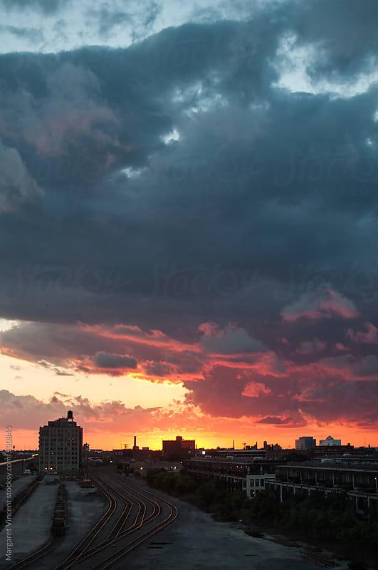sunset over urban neighborhood by Margaret Vincent for Stocksy United