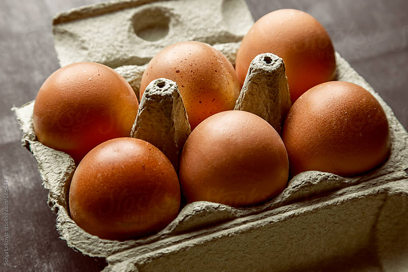 six pack of eggs on the table by Sonja Lekovic for Stocksy United