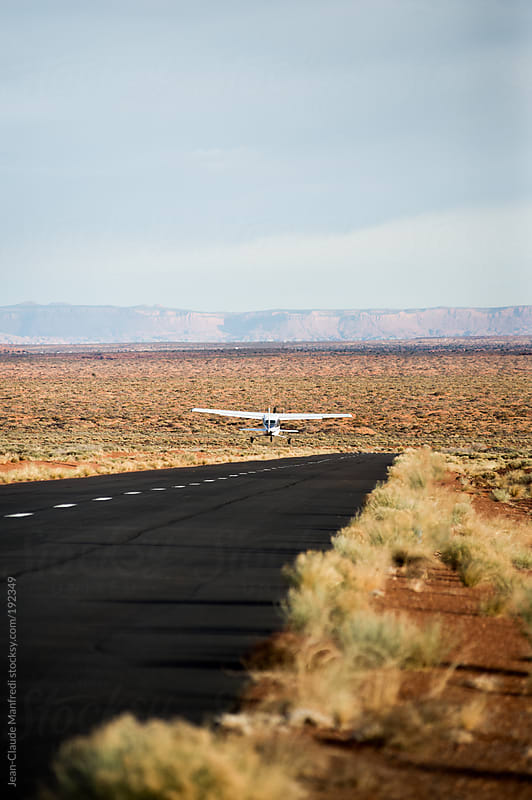 Small plane take off in the monument valley landscape by Jean-Claude Manfredi for Stocksy United