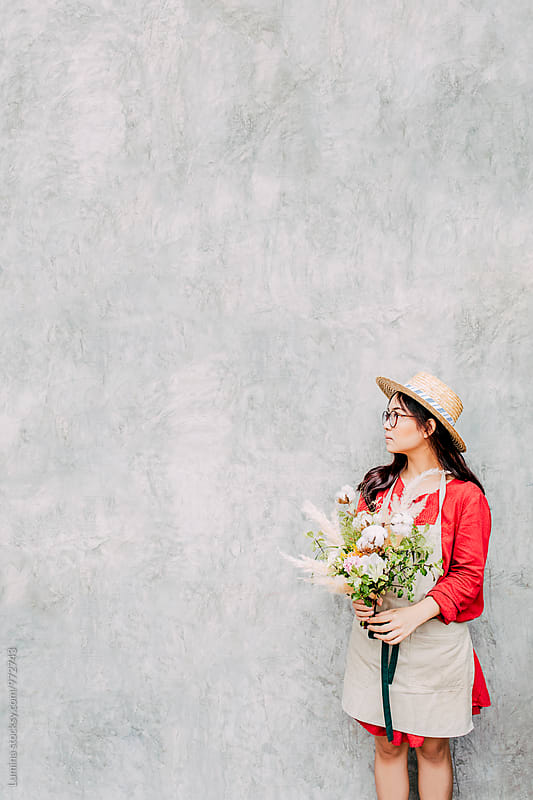 Florist Holding a Flower Bouquet by Lumina for Stocksy United