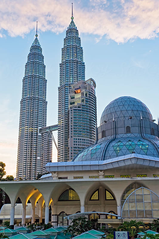 Asia, Malaysia, Selangor State, Kuala Lumpur, Mosque in the KLCC city park grounds at the base of the iconic Petronas Towers, 88 storey steel clad twin towers with a height of 451.9 metres by Gavin Hellier for Stocksy United