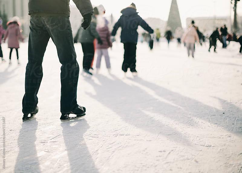 ice skating people by Alexey Kuzma for Stocksy United