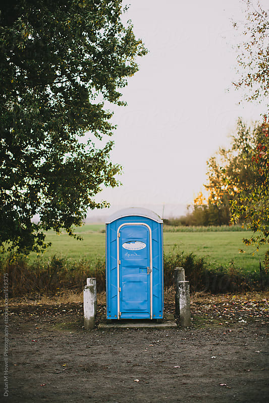 Porta Potty in Nature by Dylan M Howell Photography for Stocksy United