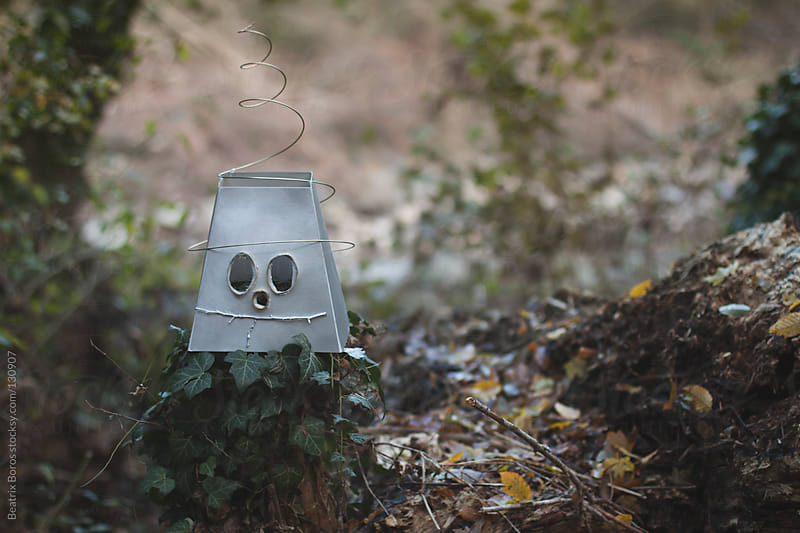 Homemade robot mask in the forest by Beatrix Boros for Stocksy United