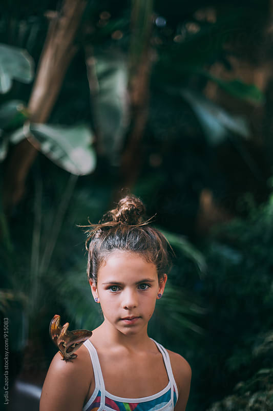Portrait of young girl with real butterfly by Lydia Cazorla for Stocksy United