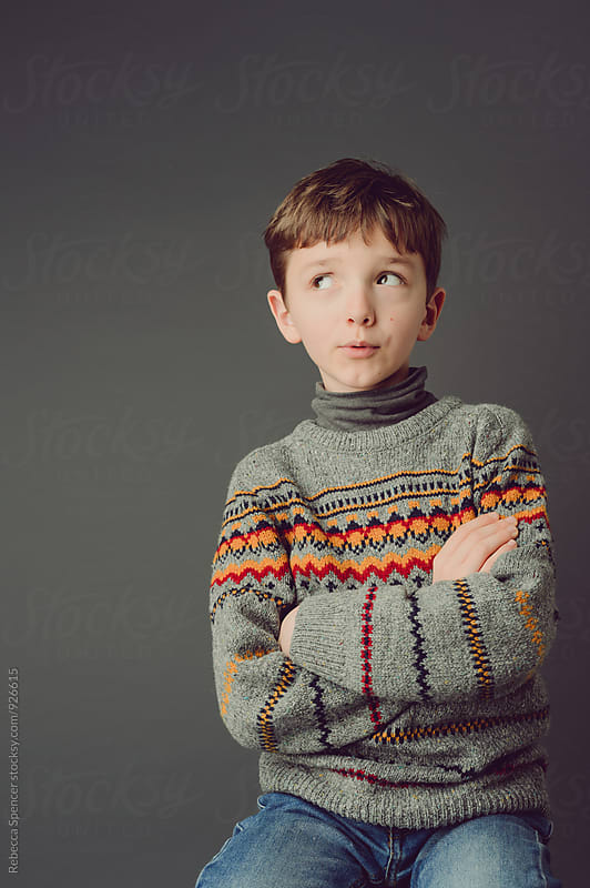 Portrait of boy looking at copy space by Rebecca Spencer for Stocksy United